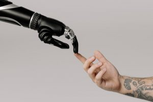 Robotic prosthesis touches a human hand, biotech
