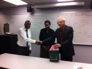Stewart Rosenberg and Leonille and Zato Kadambaya shake hands over africaphilanthropies inc and bio-investigations ltd partnering